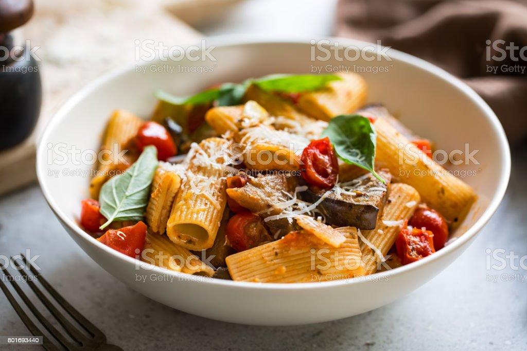 Rigatoni with Aubergine and Cherry Tomato Sauce stock photo