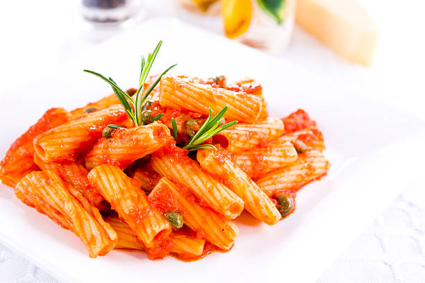 rigatoni with tomato sauce rigatoni with tomato sauce rigatoni stock pictures, royalty-free photos & images