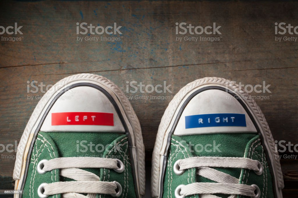 Right and left sneakers stock photo