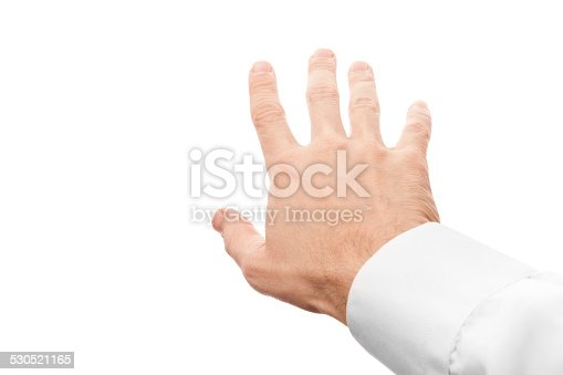 182925103 istock photo Right business man hand trying to grab something 530521165
