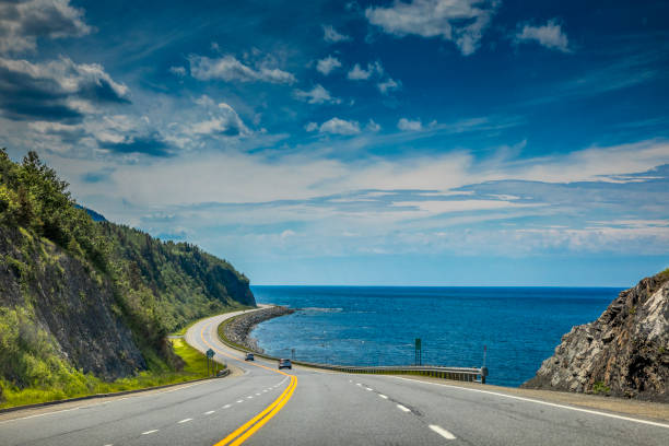 Right by the Saint Lawrence river, a look at beautiful Quebec Route 132, near Cap-au Renard (La Martre) in Haute-Gaspésie, situated in the Eastern part of the Canadian province. stock photo