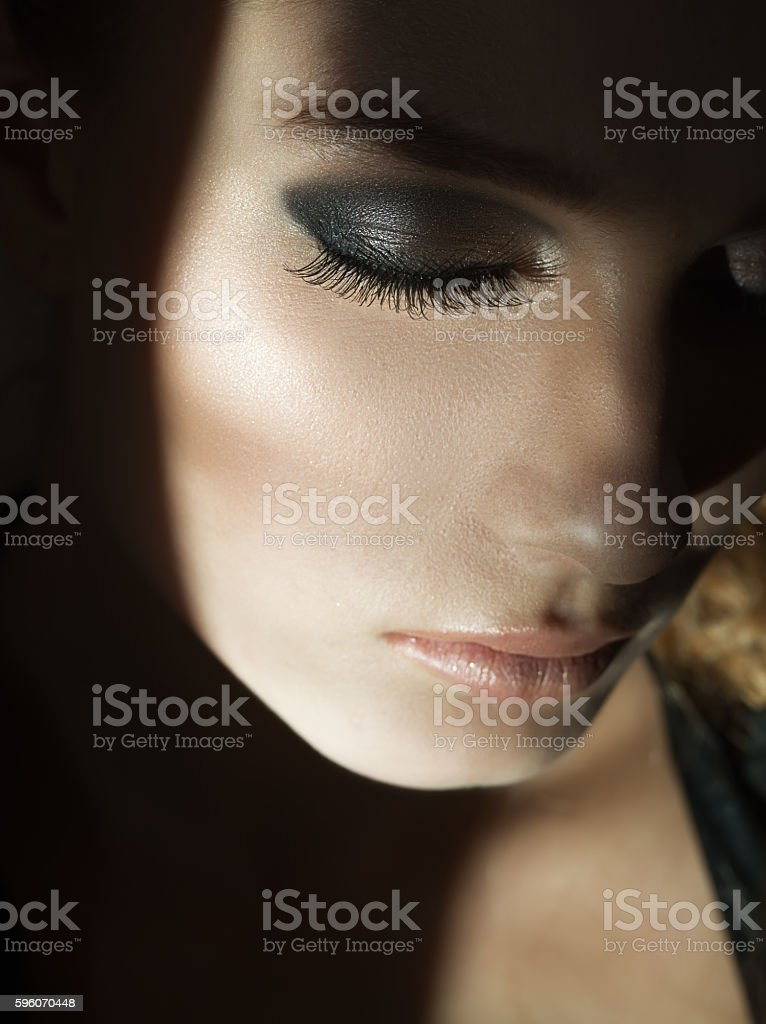 right cheek of the girl in a light spot royalty-free stock photo