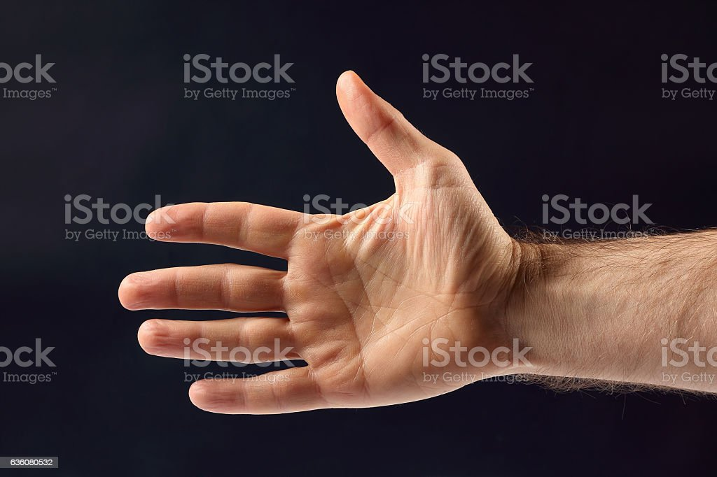 right hand men on a dark background stock photo