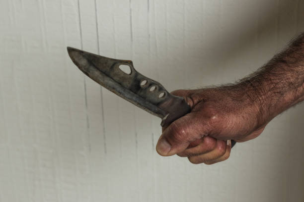 right hand men with a large hunting knife.concept - aggression, crime, violence. - knife wound stock photos and pictures