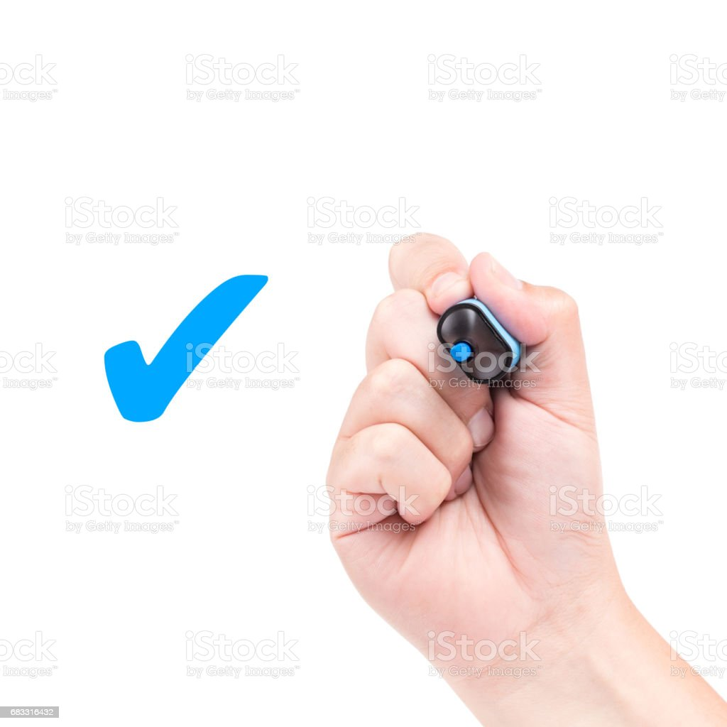 Right hand with blue marker draw a check mark foto stock royalty-free
