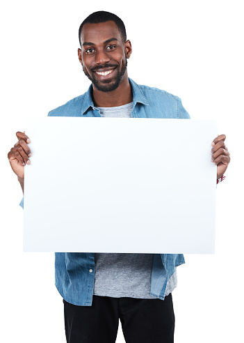 Cropped portrait of a young man holding an empty sign against a white background