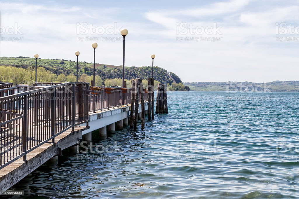 Right jetty's view of the Bracciano lake stock photo