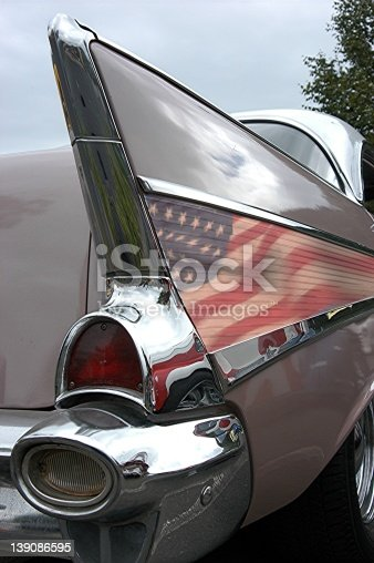 Rear View of a 1957 Chevy Tailfin and taillight.  This Chevrolet Belair is painted in two tone Dusk Pearl and Ivory White