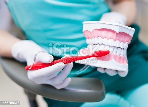 istock Right technique of cleaning teeth performed by professional dentist 486798678
