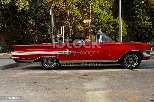 Izmir, Turkey - September 23, 2018: Right view of a red colored 1960 Chevrolet Impala.