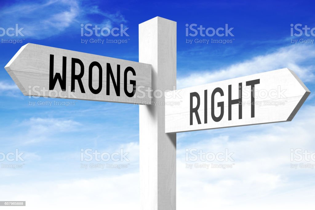 Right, wrong - wooden signpost stock photo