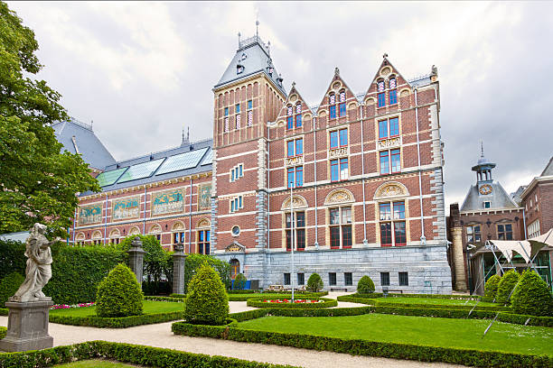 Rijksmuseum, Amsterdam. Amsterdam, Netherlands - July 1, 2012: Cortyard and entrance to the Rijksmuseum. Rijksmuseum is a Dutch national museum dedicated to arts and history. The museum is located at the Museum Square (Museumplein) in the borough Amsterdam South. rijksmuseum stock pictures, royalty-free photos & images