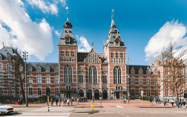 Rijksmuseum Amsterdam Amsterdam, Netherlands - May 3, 2016: Front view of the Rijksmuseum in Amsterdam. The Rijksmuseum is national museum dedicated to arts and history in Amsterdam. museumplein stock pictures, royalty-free photos & images