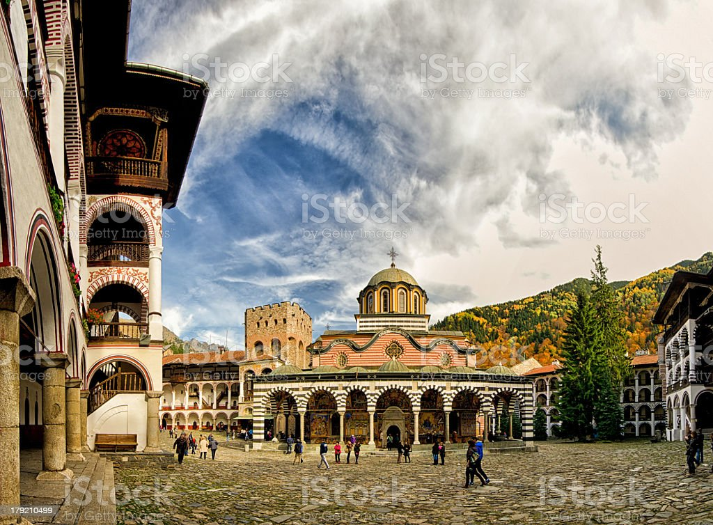 Rila Monastery plaza under blue sky with high clouds stock photo
