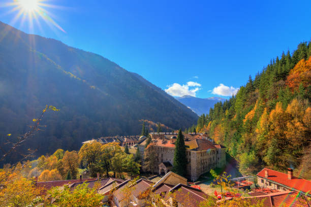 Rila monastery valley sunrise Beautiful view of the Orthodox Rila Monastery, a famous tourist attraction and cultural heritage monument in the Rila Nature Park mountains in Bulgaria monastery stock pictures, royalty-free photos & images