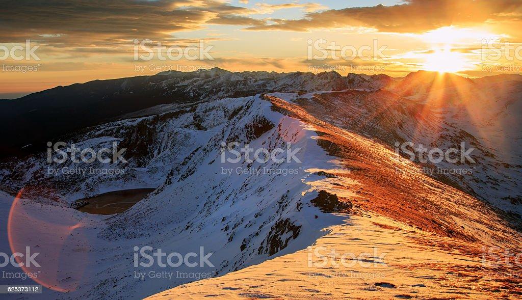 Rila Mountains ridge sunrise stock photo