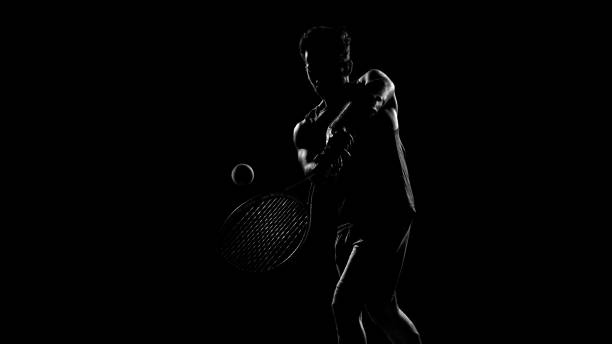 rim light artistic portrait of a male tennis player - racket sport stock pictures, royalty-free photos & images