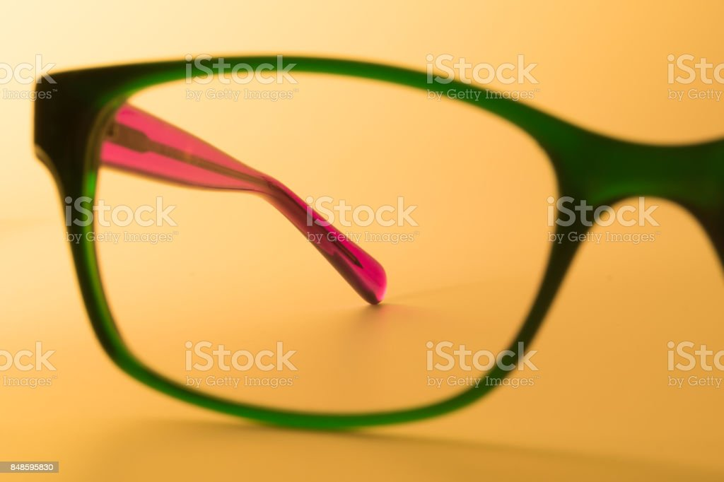 Rimmed eyeglasses closeup on a white background stock photo