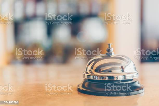 Ring bell for staff calling on the stand reception and bar background picture id1074952384?b=1&k=6&m=1074952384&s=612x612&h=eqls1mk2 njyc3nkxspjold9xrjkhm tcwiwyryxlh8=