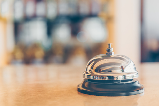 Ring Bell For Staff Calling On The Stand Reception And Bar Background Holiday And Travel Concept Stock Photo - Download Image Now