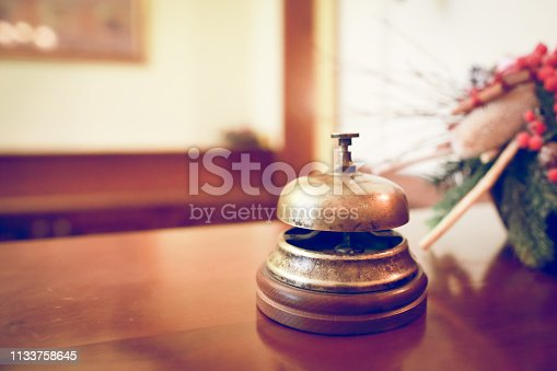 840883328 istock photo ring bell service in hotel 1133758645