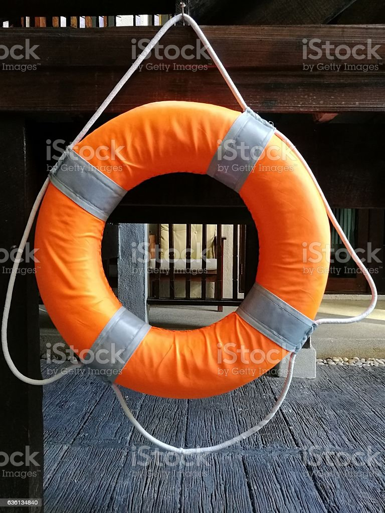 Ring buoy hanging near swimming pool for emergency stock photo