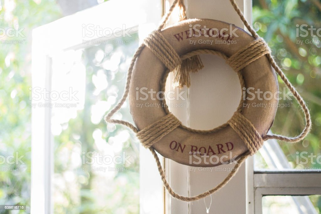 Ring Buoy Hanging next to window stock photo