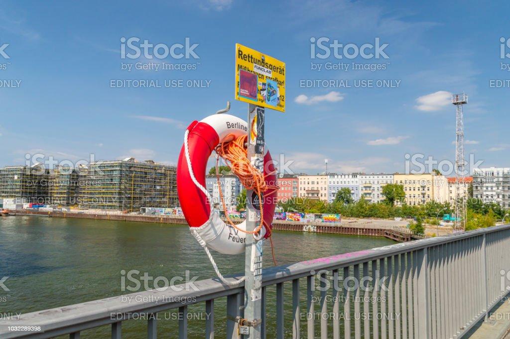 Ring buoy on Elsenbrucke bridge over Spree river. stock photo