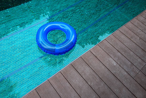 ring buoy swimming pool. - competition group stock photos and pictures