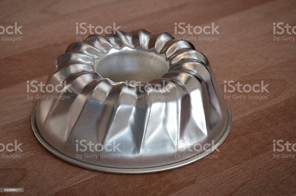 ring cake pan on wood table stock photo
