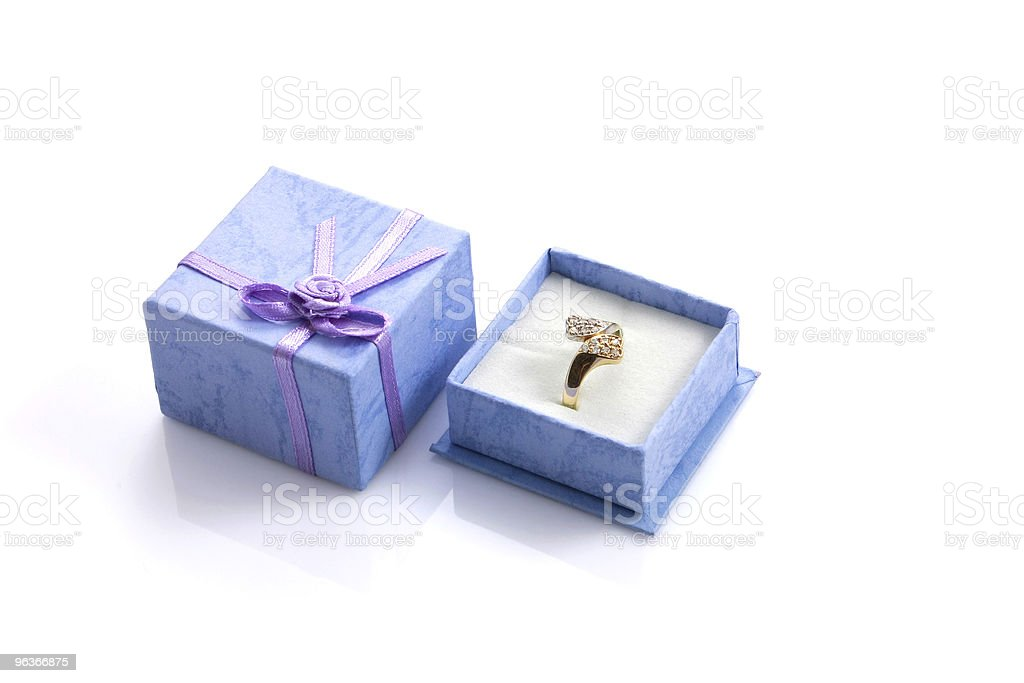 Ring in blue gift box isolated royalty-free stock photo