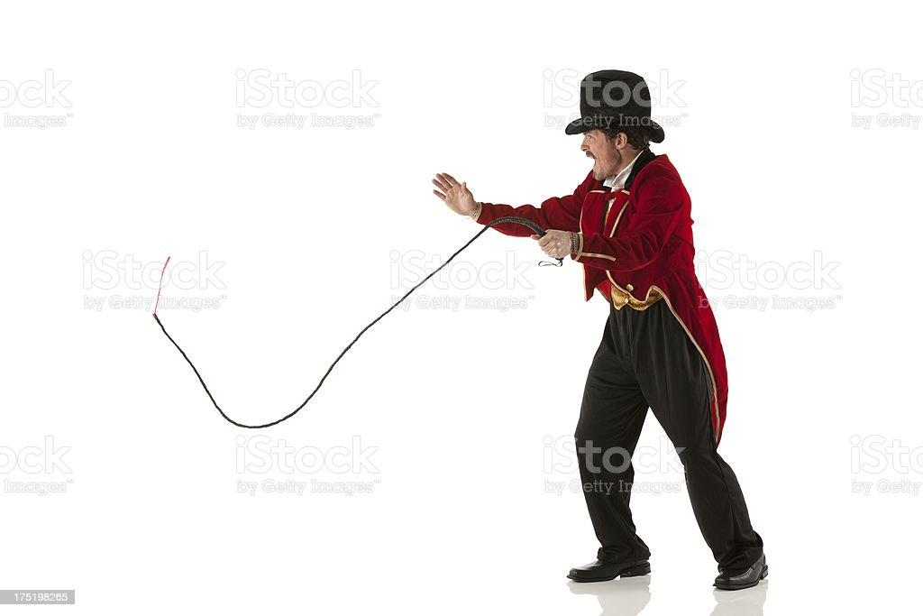 Ring master performing with a whip stock photo