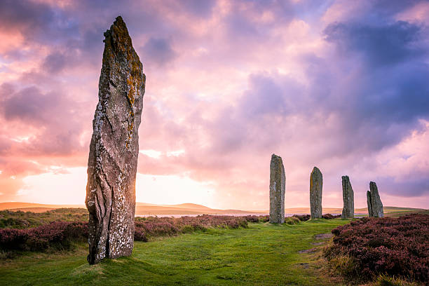 Ring Of Brodgar, Orkney The ancient standing stones of the Ring of Brodgar in the Orkney Islands off the north coast of Scotland, in the evening just at sunset. This monument in the heart of the Neolithic Orkney World Heritage Site is believed to have been built between 4000 and 4500 years ago. Originally built with sixty stones in a circle over 100 metres (over 100 yards) across, fewer than half of the stones still stand. The tallest of the stones is a little over 4.5 metres (15 feet) tall. theasis stock pictures, royalty-free photos & images