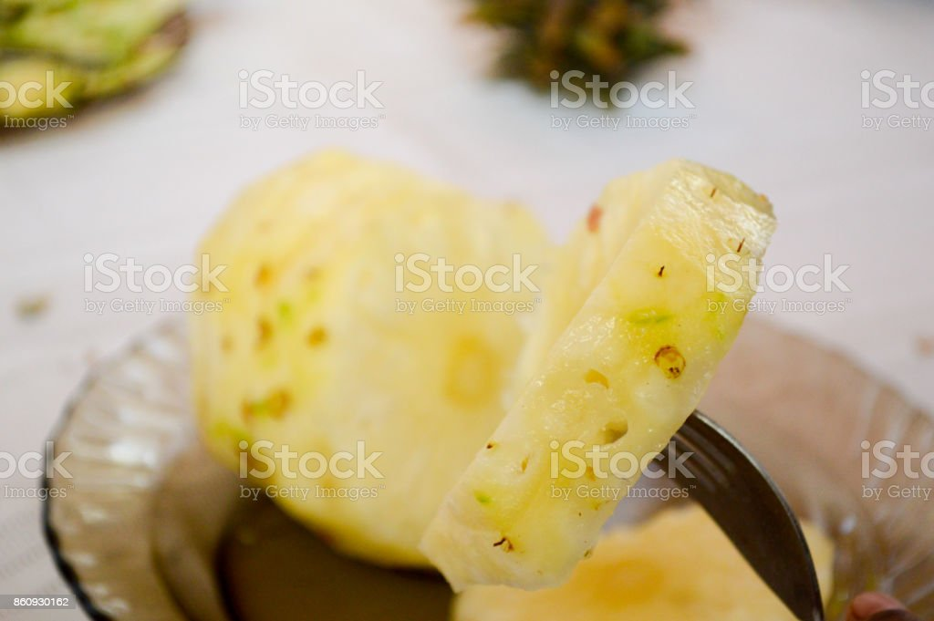Ring of pineapples cut in several portions stock photo