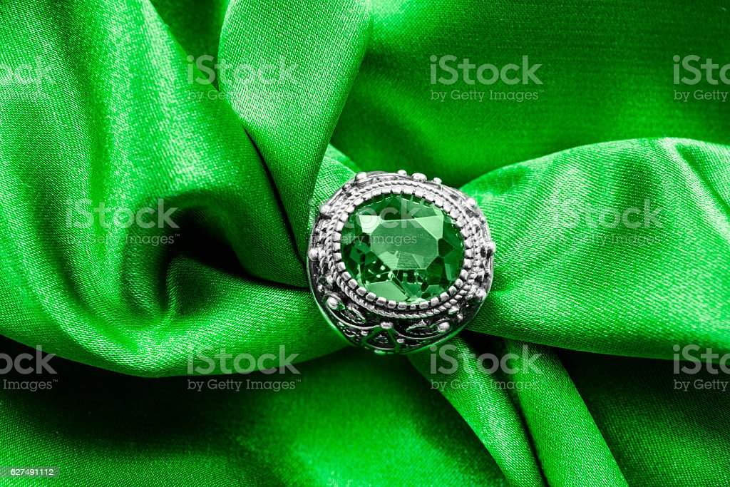 Ring on satin stock photo