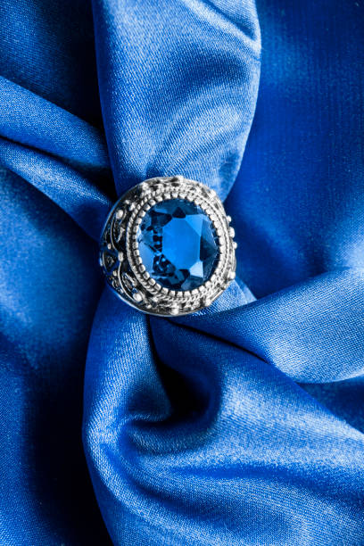 ring on satin - sapphire gemstone stock photos and pictures