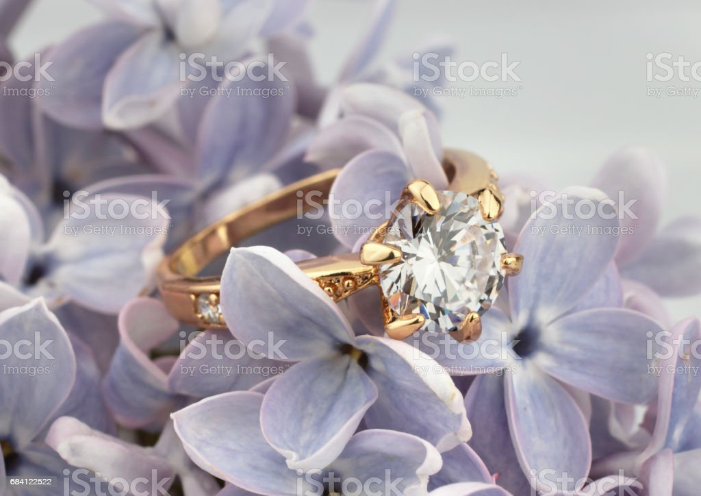 Ring with diamond on violet flower, soft focus zbiór zdjęć royalty-free