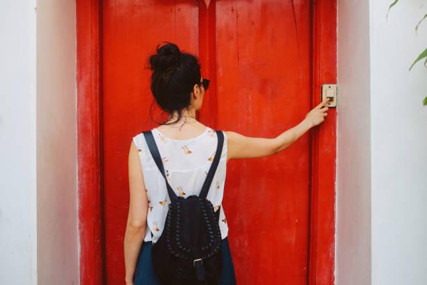 ringing the door bell - squillare foto e immagini stock