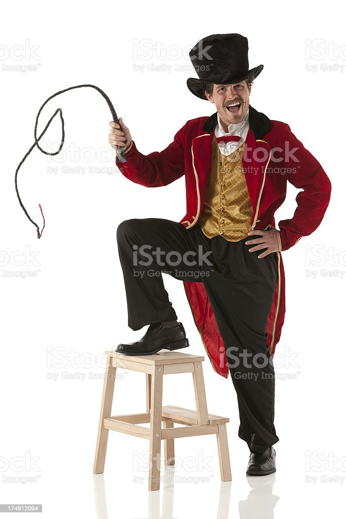 Ringmaster performing with a whip stock photo