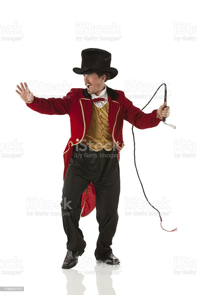 Ringmaster perfroming with a whip stock photo