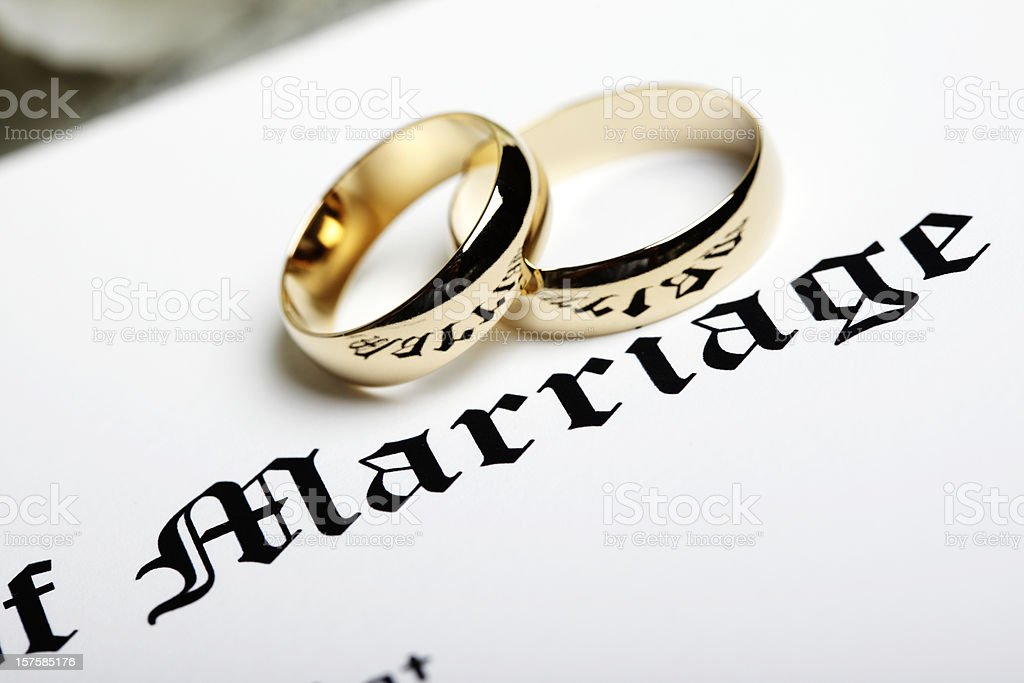 Rings and Marriage Certificate royalty-free stock photo