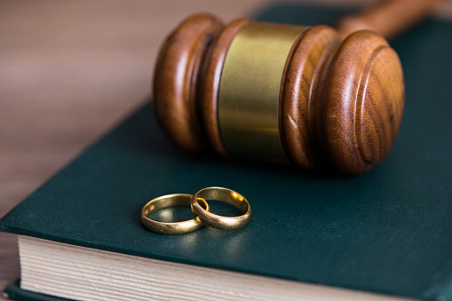 rings with judge on book on table