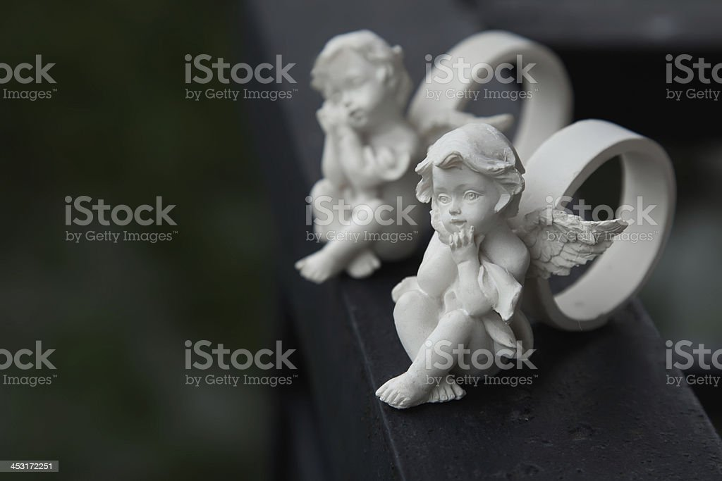 Rings with little angels stock photo