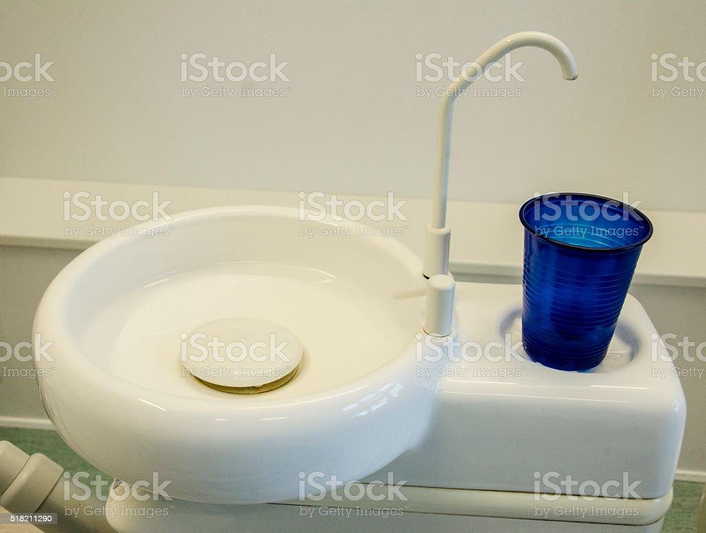 Rinsing bowl and mug at the dentist stock photo