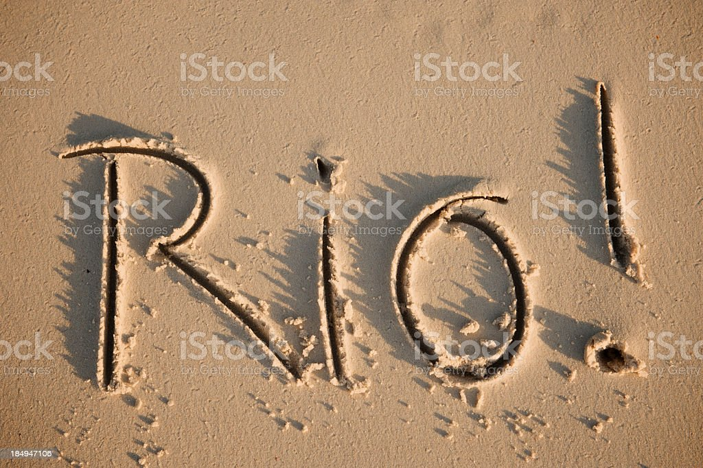 Rio! as in de Janeiro Brazil Handwritten Message Sand Beach royalty-free stock photo