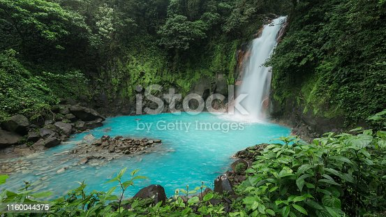 A triopical waterfall of Rio Celeste in National Park Tenorio Volcano - Costa Rica