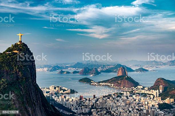Aerial view of Rio De Janeiro. Corcovado mountain with statue of Christ the Redeemer, urban areas of Botafogo, Flamengo and Centro, Sugarloaf mountain.