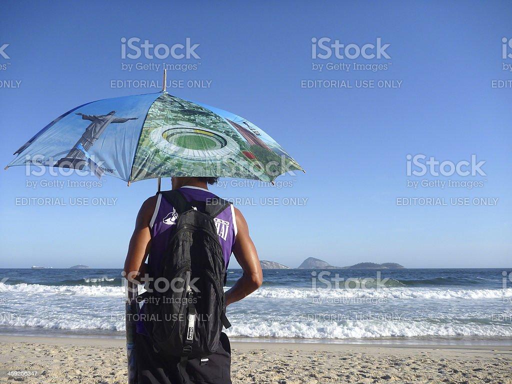 Rio de Janeiro Ipanema Beach Vendor Selling Umbrellas royalty-free stock photo
