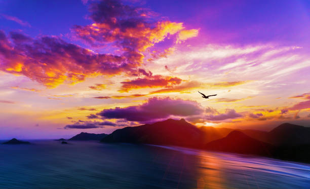 Rio De Janeiro Stunning Colorful Sunset Behind Ocean Mountains With Soft Water and Exotic Islands Landscape Panoramic View stock photo