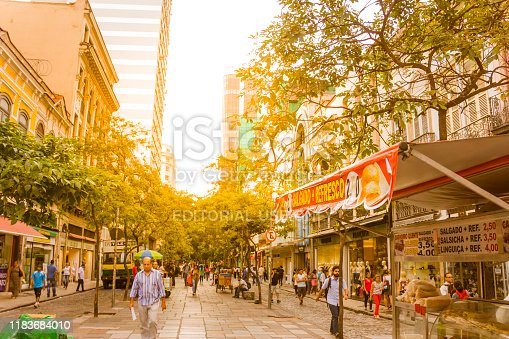 Rio de Janeiro, Brazil - September 20, 2018: General view of Rio de Janeiro's Downtown at sunset afternoon. People walking through the streets.